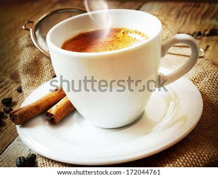 Cup of Cappucino.Italian Coffee with Coffee Beans and a Cinnamon Sticks - stock photo