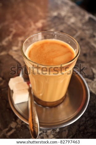 Cup of Chai Tea and Sugar Cubes - stock photo