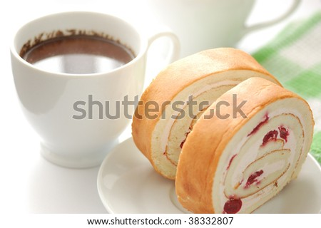 Cup of chocolate and swiss roll - stock photo