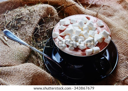Cup of cocoa with marshmallows. Shallow DOF - stock photo