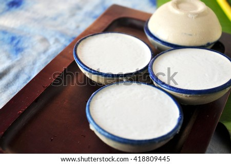 Cup of coconut milk custard Thai dessert on tray - stock photo