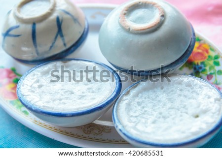 Cup of coconut milk Thai vintage dessert. - stock photo