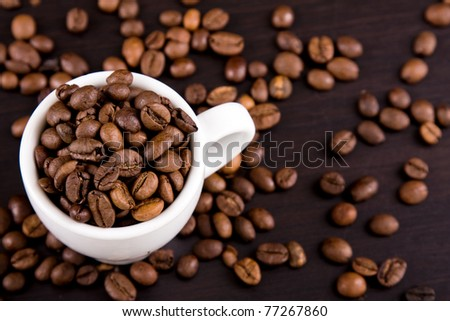Cup of coffe beans on the table