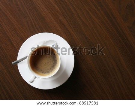 cup of coffe on elegant wooden background. - stock photo