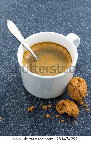 cup of coffee and almond biscuits on a dark background, top view, vertical - stock photo