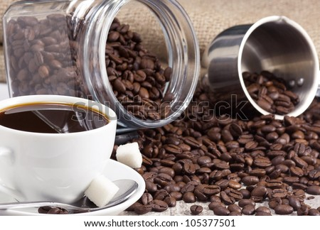 cup of coffee and beans on sack - stock photo