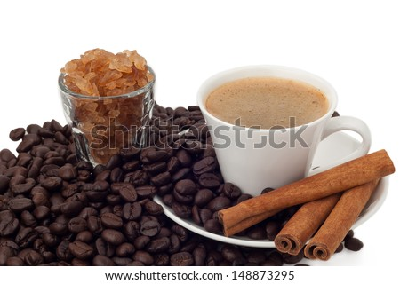 Cup of coffee and beans with crystal sugar on white background