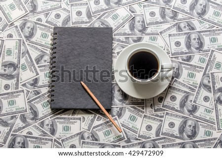 Cup of coffee and black book - stock photo