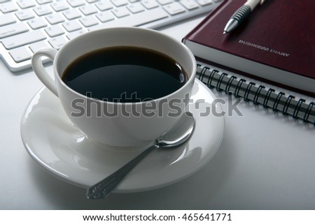 cup of coffee and business diary and keyboard