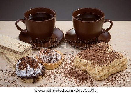 Cup of coffee and Cake on a table