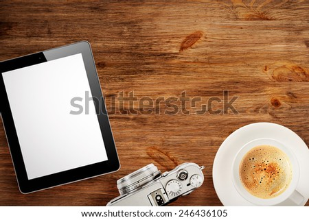Cup of coffee  and classic camera on wooden desk - stock photo