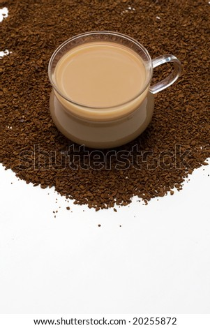 cup of coffee and coffee powder as background - stock photo