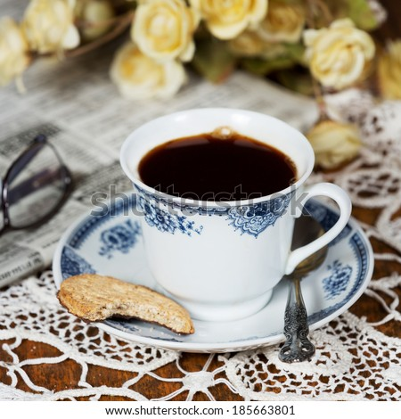 Cup of coffee and cookie. - stock photo