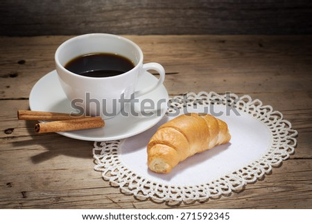 Cup of coffee and croissant - stock photo