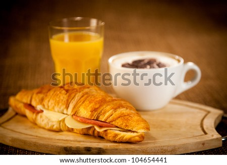 cup of coffee and croissant for breakfast - stock photo