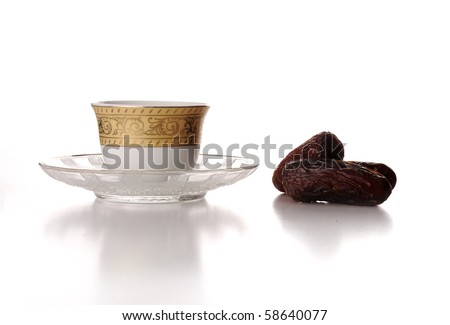 Cup of coffee and dates - stock photo
