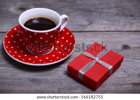 Cup of coffee and gifts at background  - stock photo