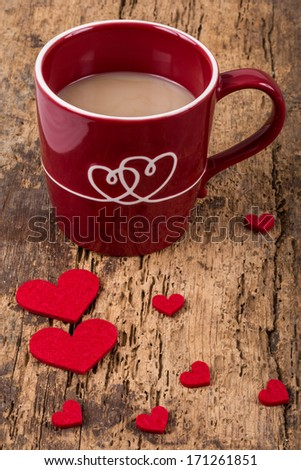 cup of coffee and hearts on wooden table