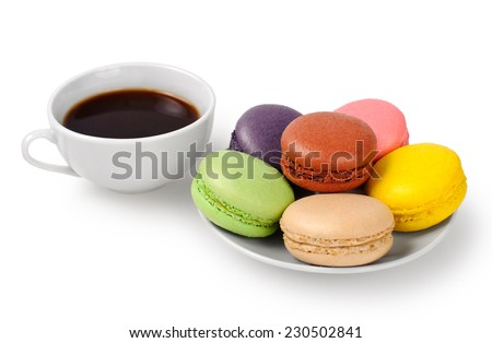 Cup of coffee and macarons isolated on white background - stock photo