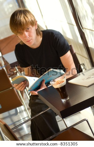 Cup of coffee and man on the background - stock photo