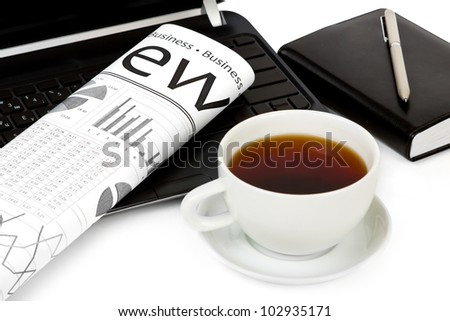Cup of coffee and morning newspaper - stock photo
