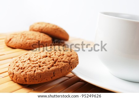 cup of coffee and oatmeal cookies.