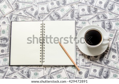 Cup of coffee and open book - stock photo
