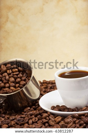 cup of coffee and pot full of beans