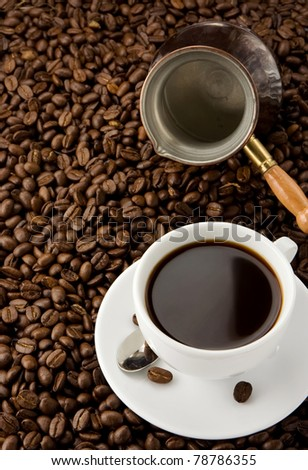 cup of coffee and pot with roasted beans - stock photo