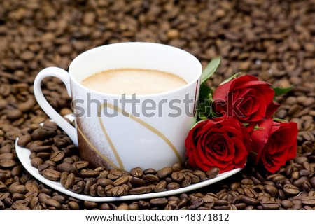 cup of coffee and red roses