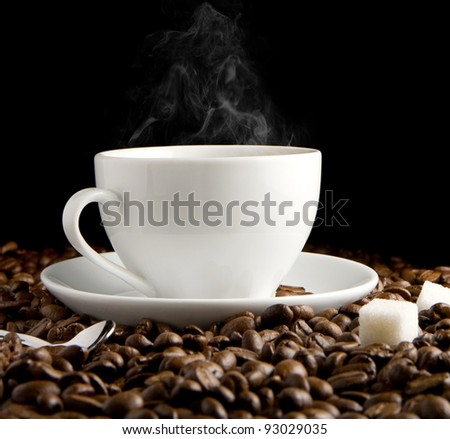 cup of coffee and steam with beans isolated on black background - stock photo