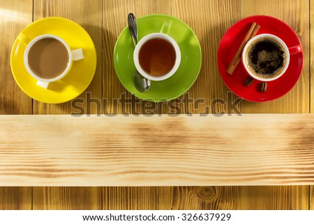 cup of coffee and tea on wooden background - stock photo
