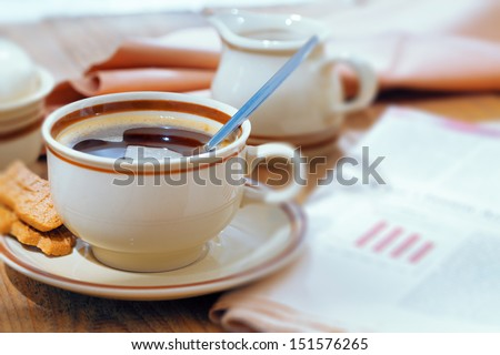 cup of coffee and the morning business newspaper - stock photo