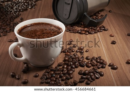 cup of coffee and Thermocup - stock photo