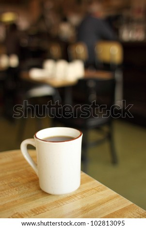 Cup of coffee at a diner. - stock photo
