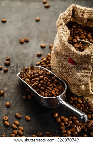 Cup of coffee, bag and scoop on old rusty background - stock photo