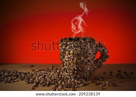 Cup of coffee beans, Made a coffee cup with coffee beans, Real photo, not 3D render. Smoke made with adobe photoshop cs6.  - stock photo