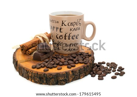 Cup of coffee, chocolate, cinnamon and coffee beans on the stump isolated on white background