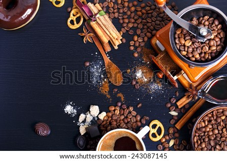 Cup of coffee, cinnamon sticks and coffee beans - stock photo