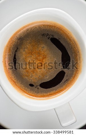 Cup of coffee closeup shot from above - stock photo