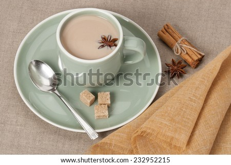 Cup Of Coffee, Cocoa or Tea With Milk And Spices. Old Silver Spoon. Natural Linen Table Cloth. - stock photo