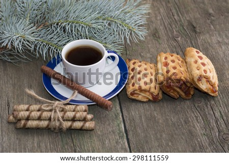 cup of coffee, cookies and fir-tree branch - stock photo
