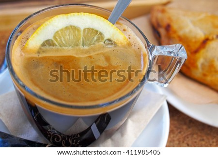 cup of coffee espresso with lemon - stock photo