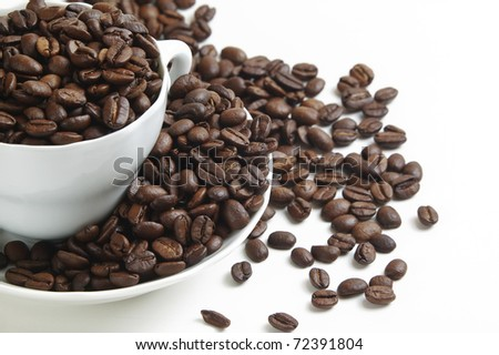 cup of coffee full of coffee beans 6322