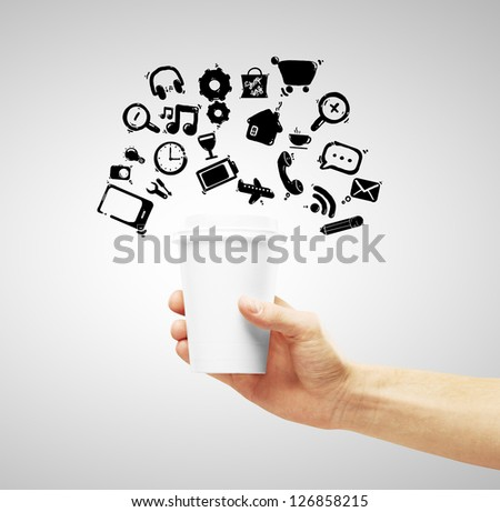 cup of coffee in hand and social media symbol - stock photo