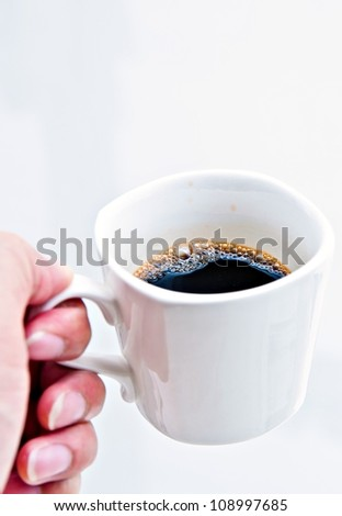 Cup of coffee in  hand on white background - stock photo