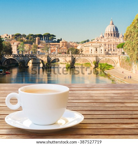 Cup of coffee in Rome with view of Tiber river and st Peters cathedral, Italy - stock photo
