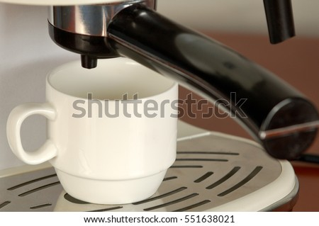 cup of coffee in the coffee machine