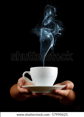 Cup of coffee in the women's hand on black background - stock photo
