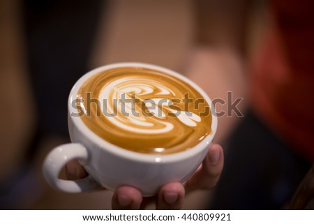 cup of coffee latte art in coffee shop vintage color tone, Making of cafe latte art, heart shape - stock photo